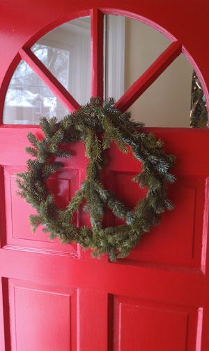 peaace wreath on a red door